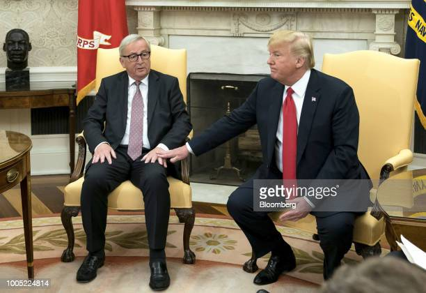Jean-Claude Juncker, president of the European Commission, left, speaks as U.S. President Donald Trump, listens during a meeting in the Oval Office...