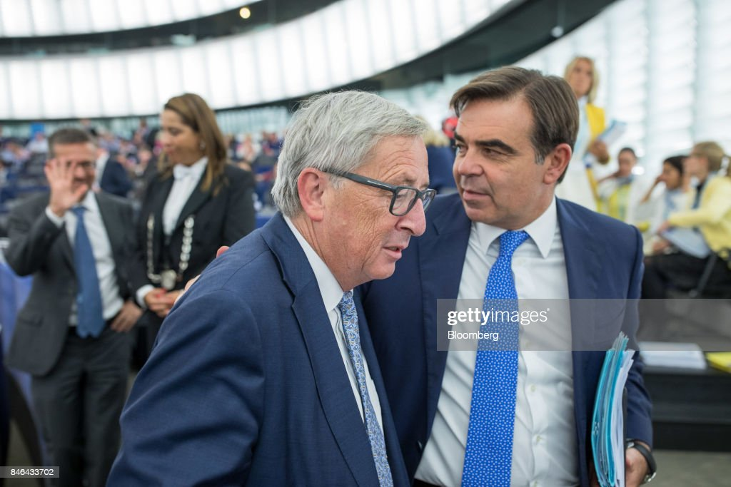 Jean-Claude Juncker, president of the European Commission, left, speaks with Margaritis Schinas, chief spokesman of the European Commission, following the State of the Union speech at the European Parliament in Strasbourg, France, on Wednesday, Sept. 13, 2017. In a sign of the EUs renewed confidence, Juncker will push for free-trade pacts withAustralia and New Zealandat a time when the U.S. is turning inward, along with a bloc-wide system for screening foreign takeovers and deeper euro-area banking integration. Photographer: Jasper Juinen/Bloomberg via Getty Images