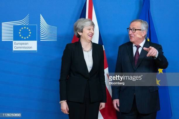 JeanClaude Juncker president of the European Commission right speaks with Theresa May UK prime minister during a photo opportunity ahead of talks in...