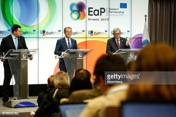 JeanClaude Juncker president of the European Commission right speaks while Donald Tusk president of the European Union center and Juri Ratas...
