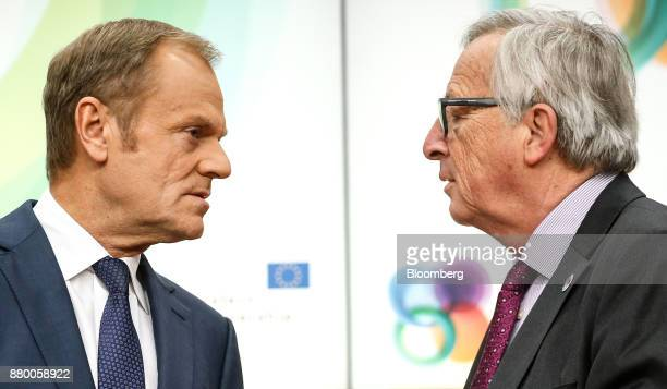 JeanClaude Juncker president of the European Commission right speaks with Donald Tusk president of the European Union before the start of a news...