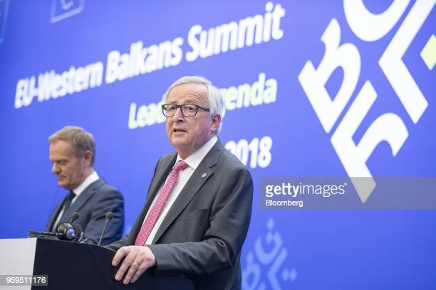 JeanClaude Juncker president of the European Commission right speaks beside Donald Tusk president of the European Union during a news conference at a...