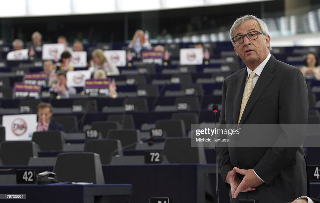 Jean-Claude Juncker, President of the European Commission, speaks as members of the right wing section of the parliament hold placards agains the TTIP Agreement in the Plenary room of the European Parliament on July 7, 2015 in Strasbourg, France. President of the EU Parliament Martin Schulz has said that the consequences of the Greek referendum result, which rejected the European Bailout deal with great majority, has increased the risks of national bankruptcy in Greece.
