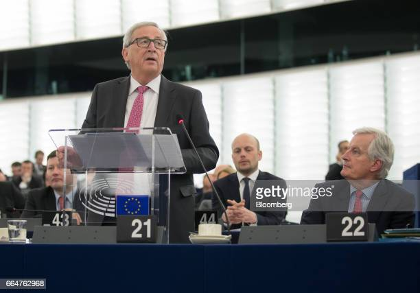 JeanClaude Juncker president of the European Commission speaks as Michel Barnier the European Union's chief Brexit negotiator right looks on ahead of...