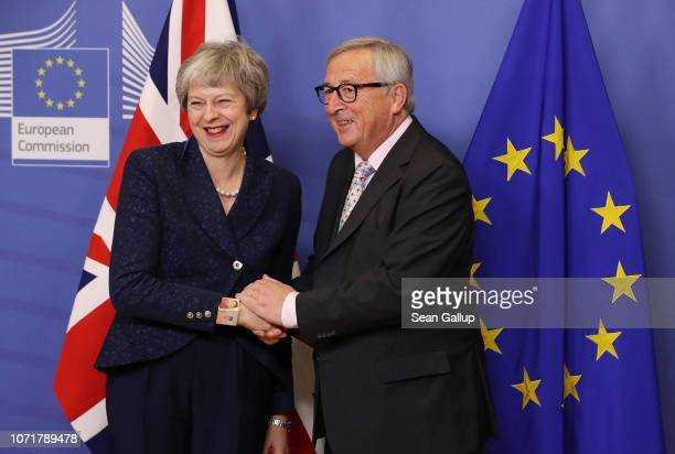 JeanClaude Juncker President of the European Commission welcomes British Prime Minister Theresa May at the Commission the day before a summit of the...