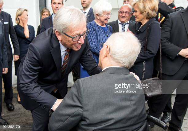 JeanClaude Juncker the president of the European Commission congratulates the German finance minister Wolfgang Schäuble on his 75th birthday in the...