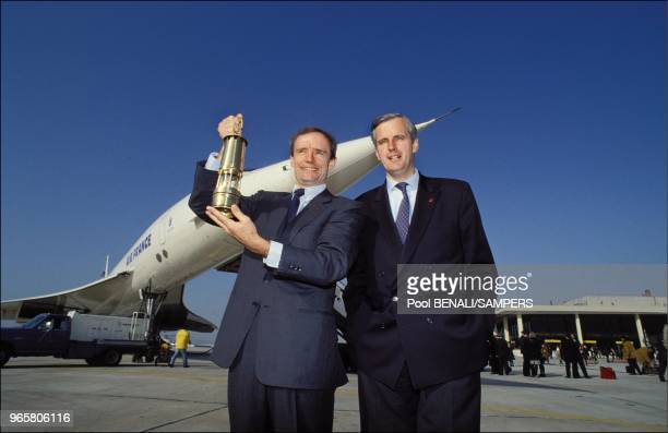 JeanClaude Killy and Michel Barnier in front of Concorde jet