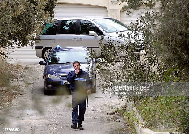 JeanClaude Mas leaves his companion's home in a gendarmerie car on January 26 2012 in SixFourslesPlages southern France after the President of Poly...