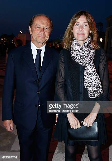 JeanClaude Meyer and Nathalie BlochLaine attend the Dinner At 'Fondazione Cini Isola Di San Giorgio' 2015 Venice Biennale on May 6 2015 in Venice...