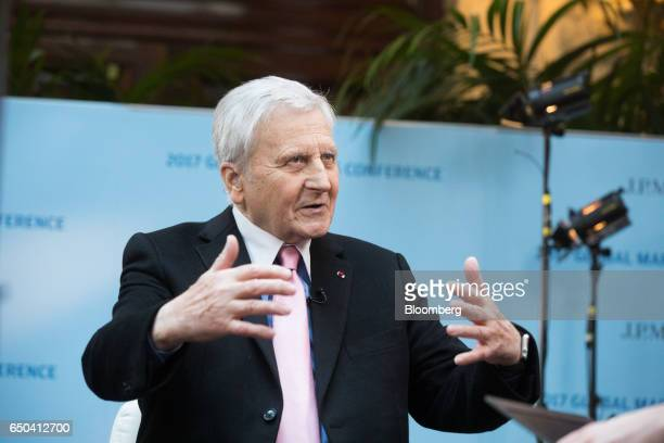 JeanClaude Trichet chief executive officer of the Group of Thirty and former president of the European Central Bank gestures while speaking during a...