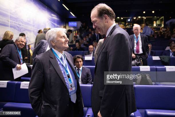 JeanClaude Trichet former president of the European Central Bank left speaks to David Malpass president of the World Bank Group during the 75th...