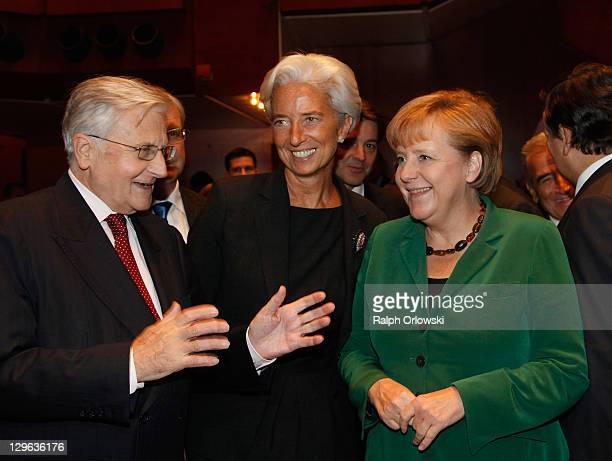 JeanClaude Trichet president of the European Central Bank Christine Lagarde managing director of the International Monetary Fund and German...