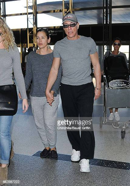 JeanClaude Van Damme and Gladys Portugues are seen at LAX on January 31 2015 in Los Angeles California