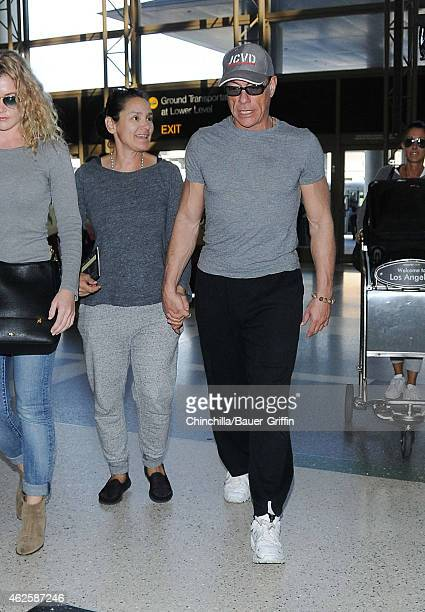 Jean-Claude Van Damme and Gladys Portugues are seen at LAX on January 31, 2015 in Los Angeles, California.