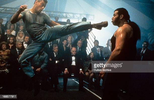 Jean-Claude Van Damme kicks an opponent in a scene from the film 'Kickboxer', 1991.