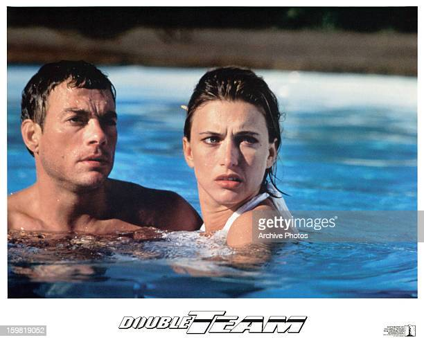 JeanClaude Van Damme swims with Natacha Lindinger in a scene from the film 'Double Team' 1997
