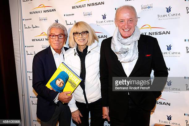 JeanDaniel Lorieux Mireille Darc and her husband Pascal Desprez attend JeanDaniel Lorieux signs his Book 'Sunstroke' at the Art Bookshop of the...