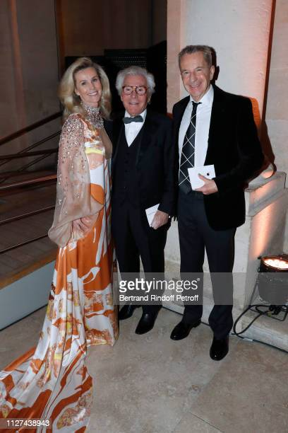 """Jean-Daniel Lorieux standing between his companion Laura Restelli-Brizard and Victor Spahn attend the 19th Gala Evening of the """"Paris Charter Against..."""