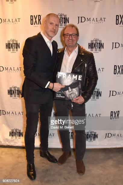JeanDavid Malat and Alan Chapman attend the opening of 'FRAME' an exhibition of photographs by Alan Chapman at BXR London on March 6 2018 in London...