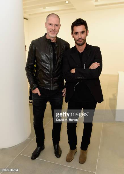 JeanDavid Malat and JeanFernandez Versini attend the private view of 'The Disasters of Everyday Life' by Jake Dinos Chapman at Blain|Southern on...