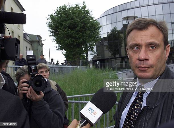 JeanDenis Lejeune the father of slain victim Julie Lejeune arrives 22 June 2004 at the courthouse in the southeastern Belgian town of Arlon for the...