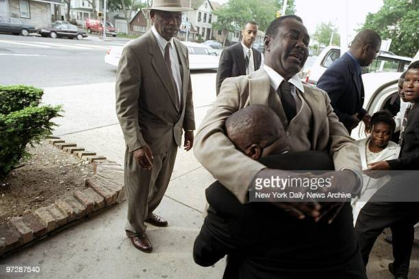 JeanElvius Auguste father of Wendy's massacre victim Jean Dumel Auguste cries as he is carried into the wake for his son at the Guarino Funeral Home...