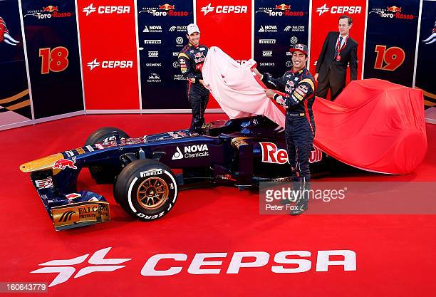 JeanEric Vergne of France and Scuderia Toro Rosso and Daniel Ricciardo of Australia and Scuderia Toro Rosso unveil the new STR8 car during the Toro...