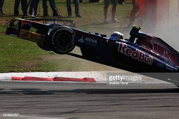 JeanEric Vergne of France and Scuderia Toro Rosso crashes out during the Italian Formula One Grand Prix at the Autodromo Nazionale di Monza on...