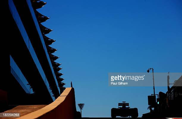 Jean-Eric Vergne of France and Scuderia Toro Rosso drives down the pitlane during practice for the Abu Dhabi Formula One Grand Prix at the Yas Marina...