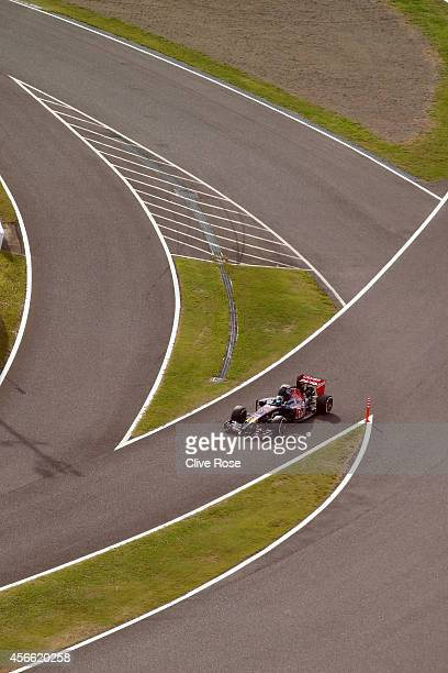 JeanEric Vergne of France and Scuderia Toro Rosso drives during Qualifying for the Japanese Formula One Grand Prix at Suzuka Circuit on October 4...