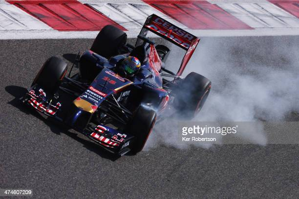 JeanEric Vergne of France and Scuderia Toro Rosso locks up as he drives during day two of Formula One Winter Testing at the Bahrain International...