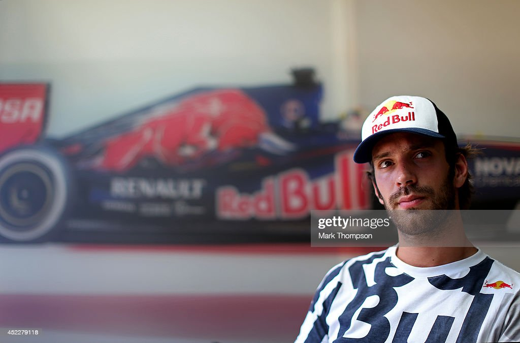Jean-Eric Vergne of France and Scuderia Toro Rosso looks on during an interview during previews ahead of the German Grand Prix at Hockenheimring on July 17, 2014 in Hockenheim, Germany.