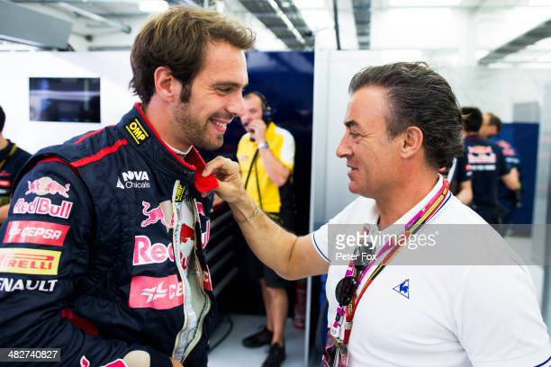 JeanEric Vergne of France and Scuderia Toro Rosso talks with former driver Jean Alesi as he prepares to drive during practice for the Bahrain Formula...