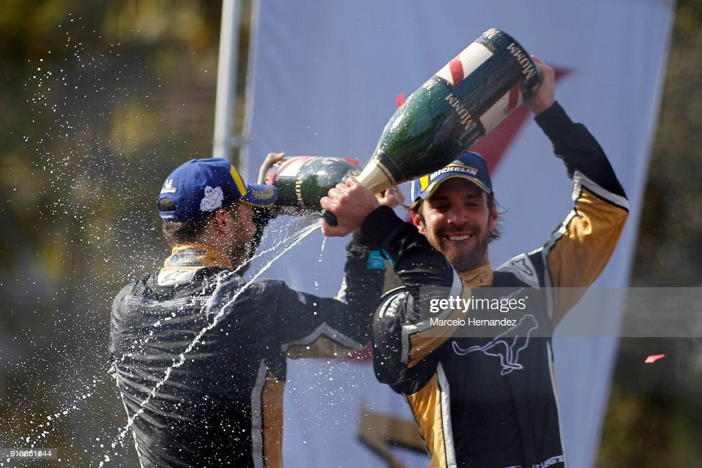 Jean-Eric Vergne, of team Techeetah celebrates his victory with teammate Andre Lotterer of Germany during the ABB Formula-E Antofagasta Minerals Santiago E-Prix on February 3, 2018 in Santiago, Chile.