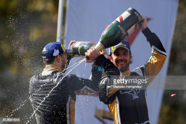 JeanEric Vergne of team Techeetah celebrates his victory with teammate Andre Lotterer of Germany during the ABB FormulaE Antofagasta Minerals...