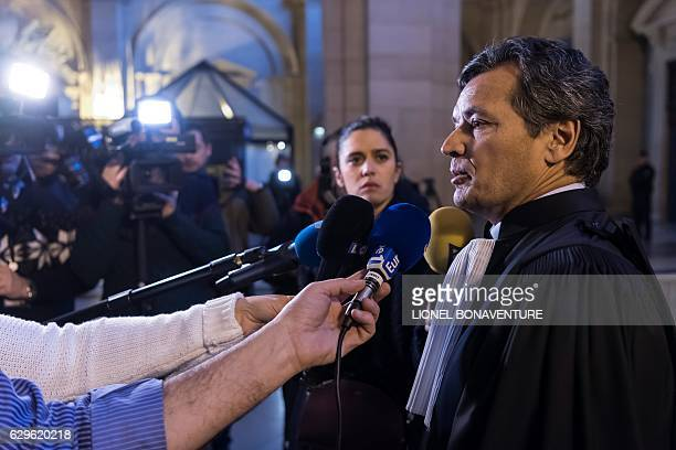 JeanEtienne Giamarchi lawyer of Stephane Richard answers journalists' questions upon his arrival at Paris' courthouse on December 14 prior to a...