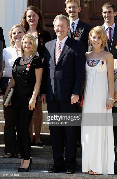 Jeanette Biedermann, German President Christian Wulff and Wolke Hegenbarth pose for a family picture at Bellevue Castle on August 26, 2011 in Berlin,...