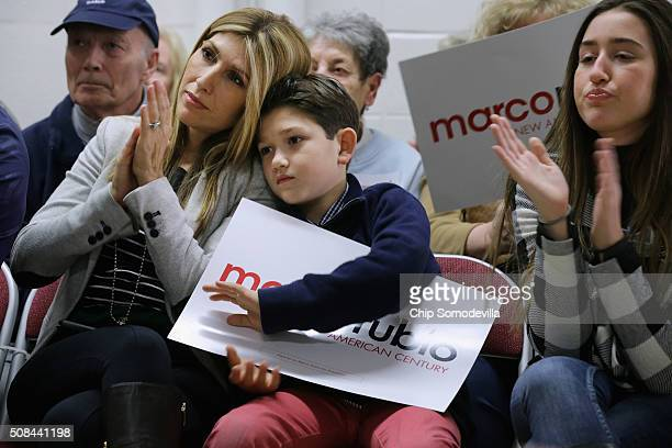 Jeanette Dousdebes Rubio the wife of Republican presidential candidate Sen Marco Rubio and their children Anthony and Amanda attend a campaign town...