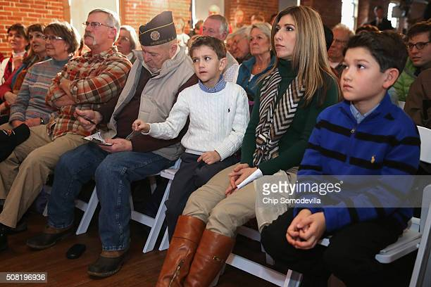 Jeanette Dousdebes Rubio wife of Republican presidential candidate Sen Marco Rubio sits inbetween their sons Dominick and Anthony while listening to...