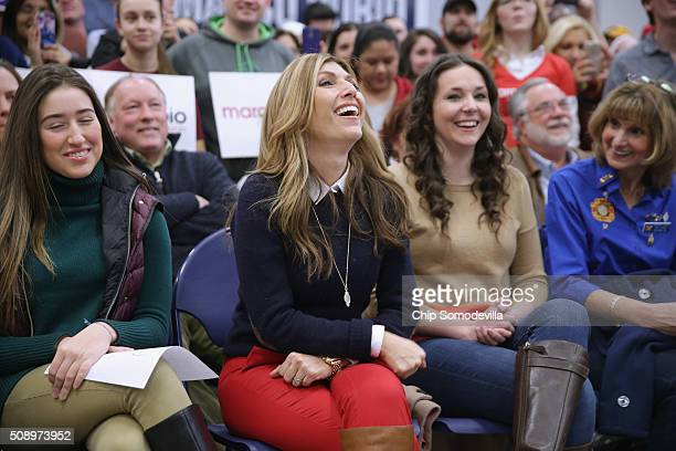 Jeanette Dousdebes Rubio wife of Republican presidential candidate Sen Marco Rubio laughs during a town hall meeting with her husband at Hills...