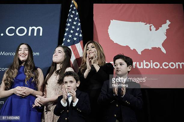 Jeanette Dousdebes Rubio wife of Senator Marco Rubio a Republican from Florida and 2016 presidential candidate second right stands on stage with...