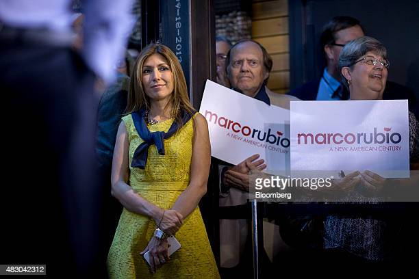 Jeanette Dousdebes wife of Senator Marco Rubio a Republican from Florida and 2016 Republican presidential candidate looks on as Rubio speaks during a...