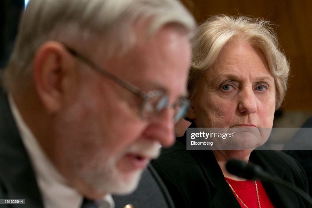 Jeanette Dwyer, president of the National Rural Letter Carriers' Association, right, looks on as Cliff Guffey, president of the American Postal Workers Union, speaks during a Senate Homeland Security and Governmental Affairs Committee hearing in Washington, D.C., U.S., on Wednesday, Feb. 12, 2013. The U.S. Postal Service, which lost $1.3 billion in its first quarter, said its debt could reach $45 billion by around 2017 if Congress doesn't pass legislation allowing it to change its business model. Photographer: Andrew Harrer/Bloomberg via Getty Images