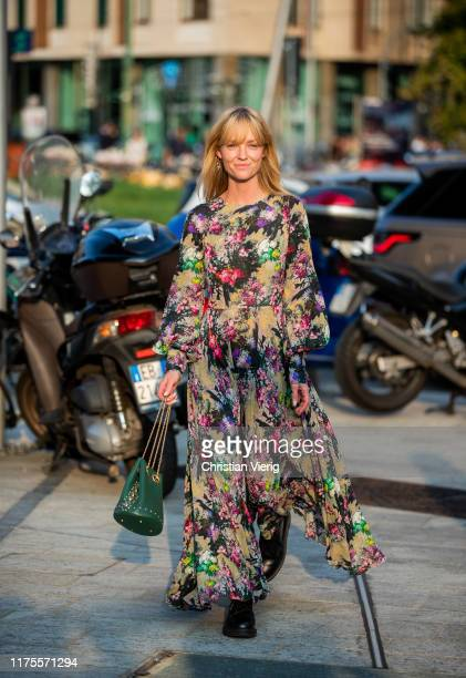 Jeanette Friis Madsen is seen wearing dress with floral print, green bag outside the Alberta Ferretti show during Milan Fashion Week Spring/Summer...