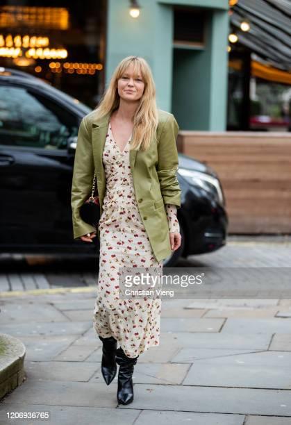 Jeanette Friis Madsen is seen wearing dress with print green blazer outside Erdem during London Fashion Week February 2020 on February 17 2020 in...