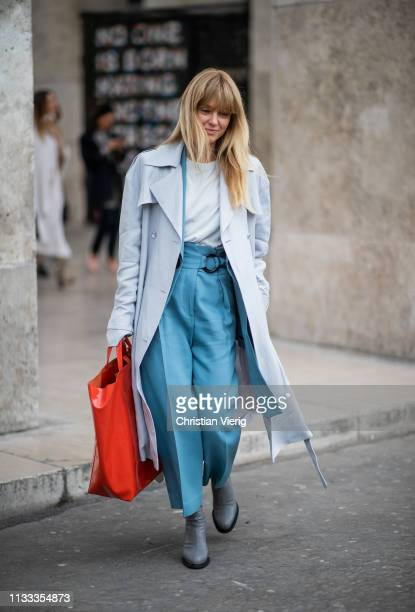 Jeanette Friis Madsen is seen wearing oversized red bag blue coat outside Cédric Charlier during Paris Fashion Week Womenswear Fall/Winter 2019/2020...