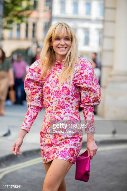 Jeanette Friis Madsen is seen wearing pink white dress with floral print outside Victoria Beckham during London Fashion Week September 2019 on...