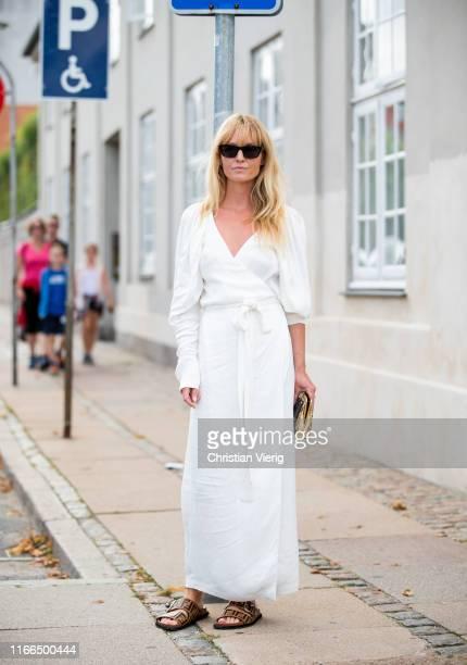 Jeanette Friis Madsen is seen wearing white dress outside Mykke Hofmann during Copenhagen Fashion Week Spring/Summer 2020 on August 06, 2019 in...