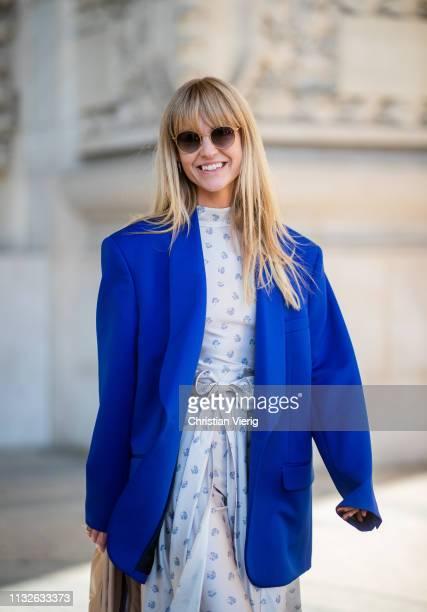 Jeanette Friis Madsen is seen wearing white dress with print blue blazer outside Maison Margiela during Paris Fashion Week Womenswear Fall/Winter...