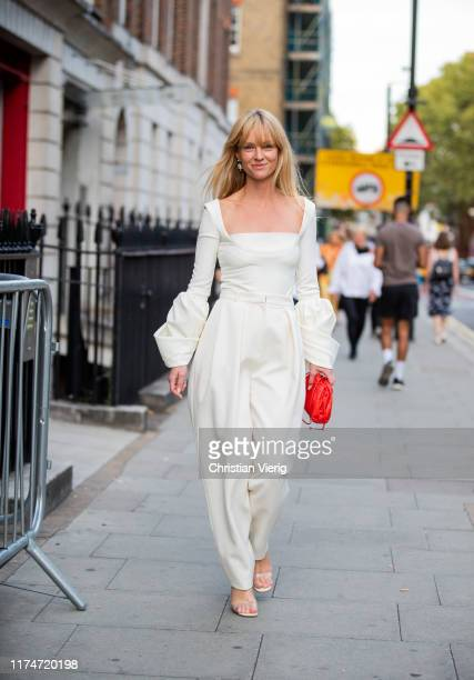Jeanette Friis Madsen is seen wearing white pants and top red bag outside Rejina Pyo during London Fashion Week September 2019 on September 14 2019...